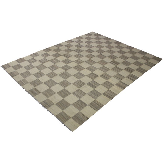 A beautiful modern kilim, handmade by Aara Rugs. It's a checkered design. and modern color that will look fantastic in any...