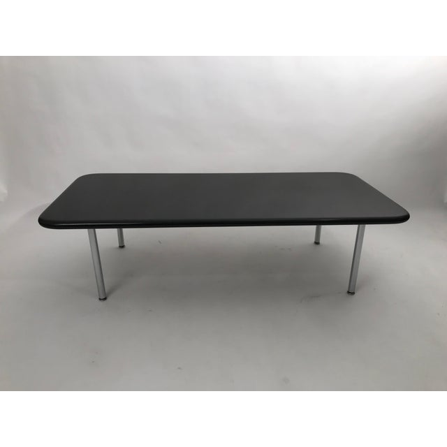 Solid granite coffee table with chrome legs by George Nelson, c. 1960 for Herman Miller. Signed with Herman Miller...