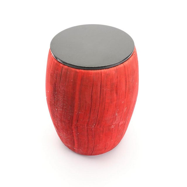 A cool and beautiful end table/taboret. The red sides are thousands of pieces of paper. The removable black top is...