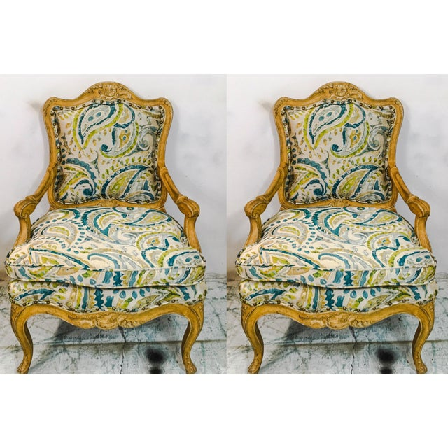 Pair of 1960s French style chairs out of New York. The upholstery is a new silk blend. The frame is like a mustard/gold...