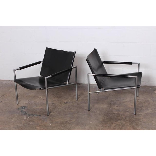 A nicely patinated pair of leather lounge chairs designed by Martin Visser for Spectrum.