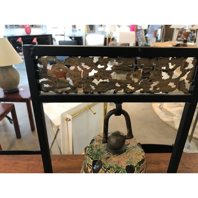 An unusual Tony Evans ceramic bell that is functional. It is mounted on an Iron frame. We have handled quite a bit of...