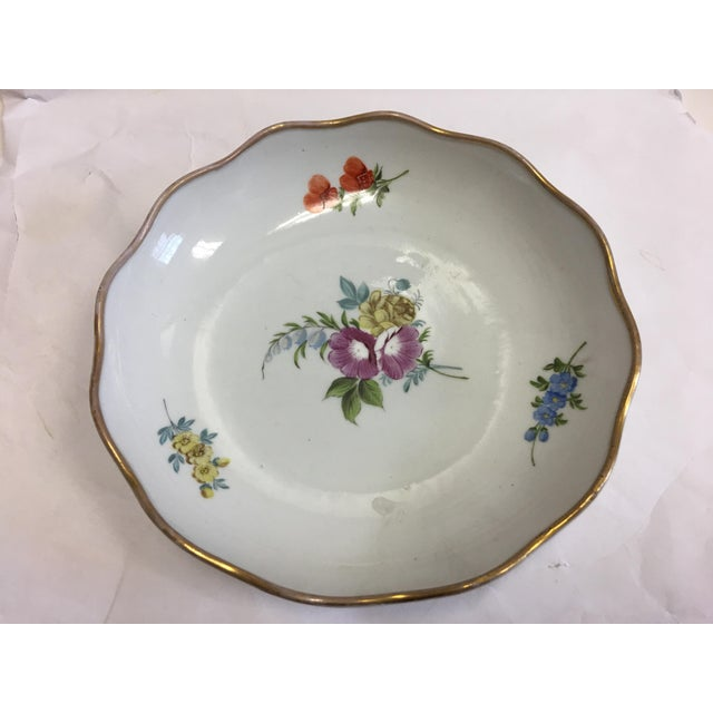 A beautiful old Porcelain dish with floral decorations and gold trim. A great design.