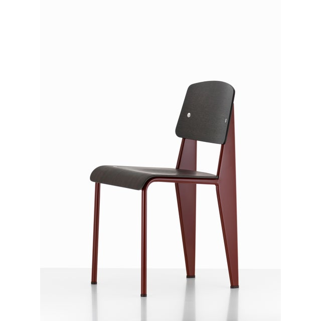 Jean Prouvé Standard chair in dark oak and black metal for Vitra. The Standard chair is an early masterpiece by the French...