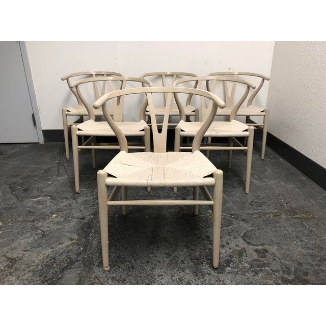 Design Plus Gallery presents a set of six Hans Wegner wishbone chairs originally from the 1950's. Originally manufactured...