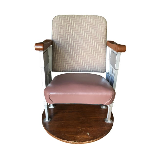 Art Deco Movie Theater Chair featuring a casted iron frame with sculpted wood arms from a Hollywood movie theater. The...