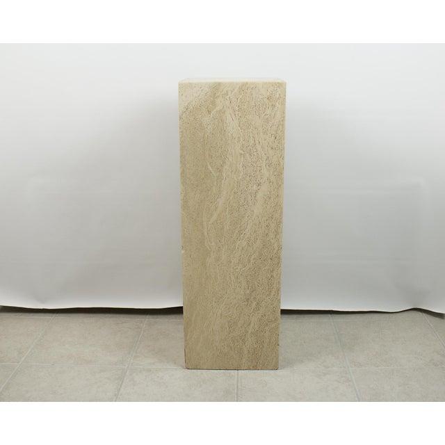 Tall rectangular shaped travertine stone pedestal. Made out of 100% natural travertine stone. Beautiful neutral light...