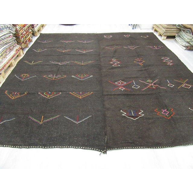 Vintage embroidered brown kilim rug from Afyon region of Turkey. Approximately 50-60 years old. In very good condition