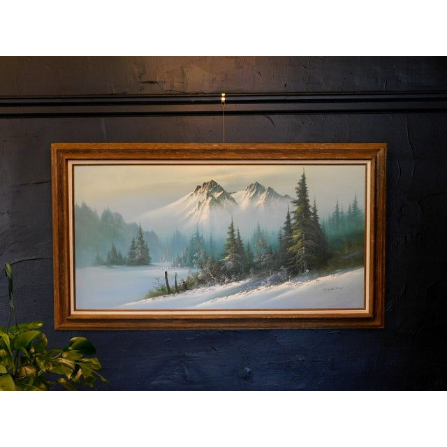An original oil painting. This beautiful image of a snow capped landscape captures a captivating scene. Signed by CJ Wilson.
