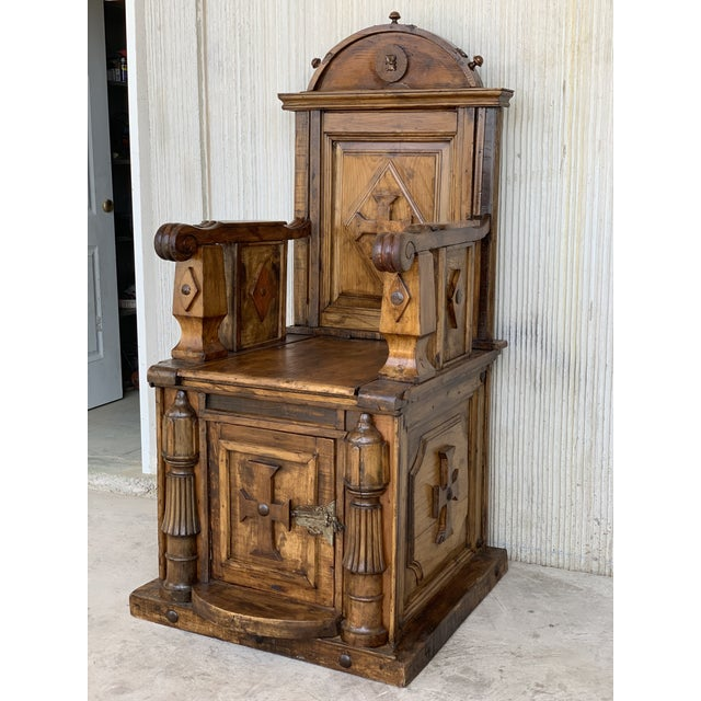 About Mid-19th imposing walnut throne armchair, the top of architectural form with carved foliate decoration above a...
