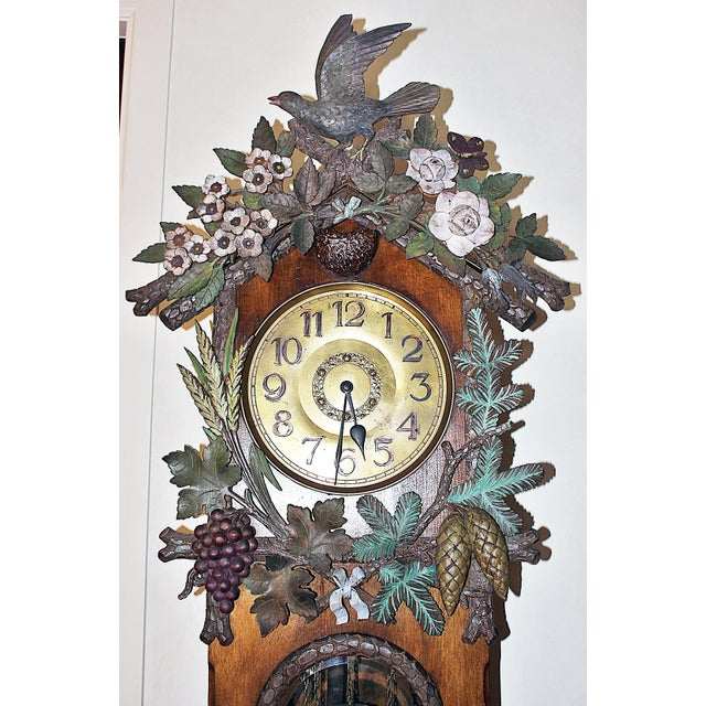Wow, one of the nicest Black Forest clocks I've seen, 19th century all hand-carved solid woods, paint decorated carvings....