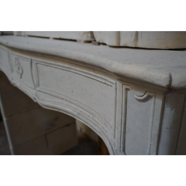 This limestone mantel originates from France during the Louis XV period. Stunning trumeau and well preserved....