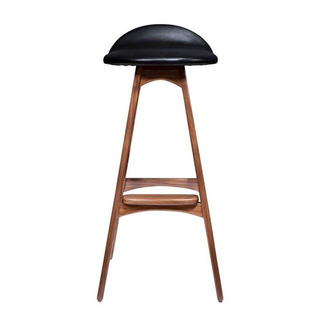 "Boyd stool shown in solid walnut with black leather seat. Seat Height -29.75"" Custom orders have a lead time of 10-12..."