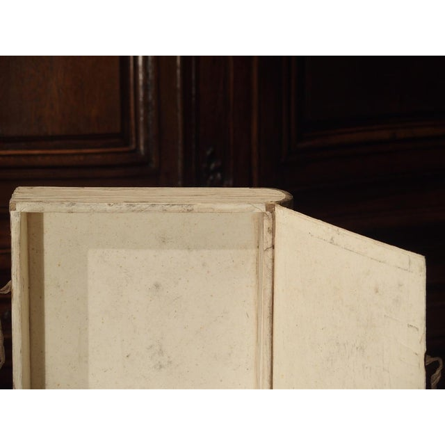 These faux book document holders are typically Italian. They started being produced in at least the 19th century and...