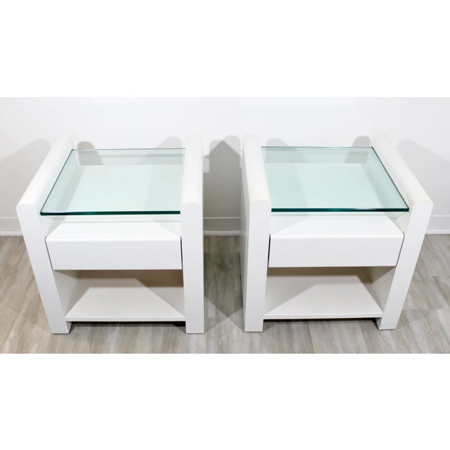 For your consideration is a unique pair of white lacquer nightstands or end/side tables, with glass tops and one drawer...