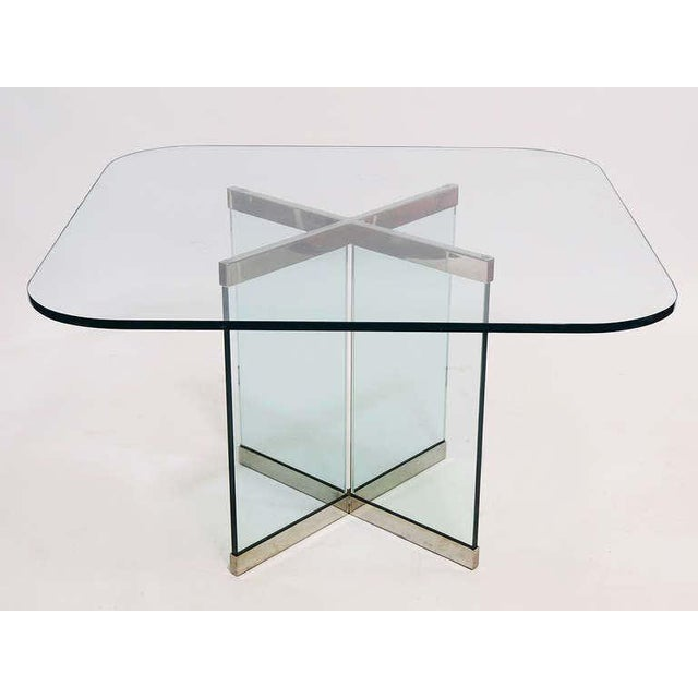 This is one of the iconic Mid-Century Modern works that Leon Rosen designed for the Pace Collection. The triangular glass...