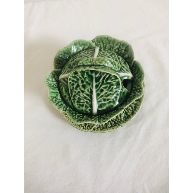 This is a beautiful cabbage shaped condiment serving bowl with under plate. Looks great mixed with blue and white. Under...