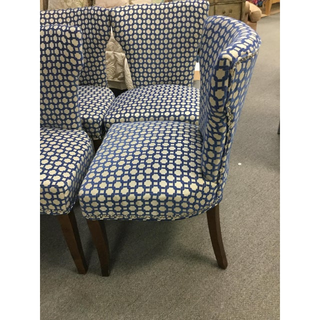 A lovely set of six side chairs in a fun textured blue and soft off white grayish with a soft silvery chain link style...