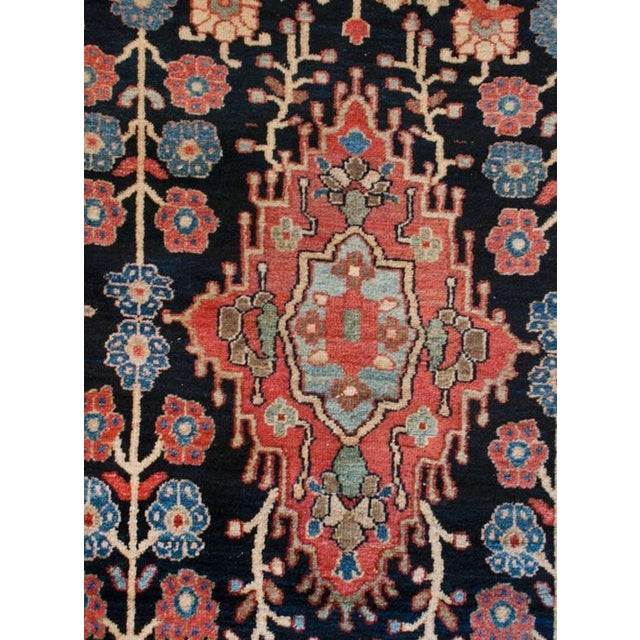 A unique early 20th century Persian Sarouk rug with an interesting English Arts & Crafts-inspired floral pattern with...