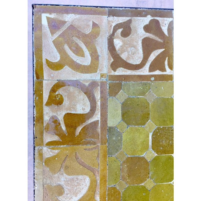 Handcrafted vintage mosaic tile tabletop, handmade using reclaimed Moroccan tiles of different shades of earth tone ochre...