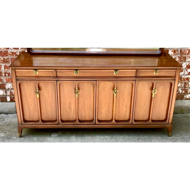 Gorgeous mid-century modern twelve drawer dresser by the White Furniture Company. Made of solid wood in a classic design...