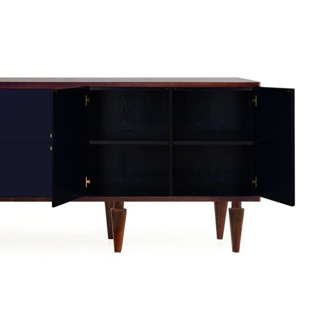 The Charles Mark Navy Credenza effortlessly blends vintage appeal with contemporary design. The case is mantled in walnut...