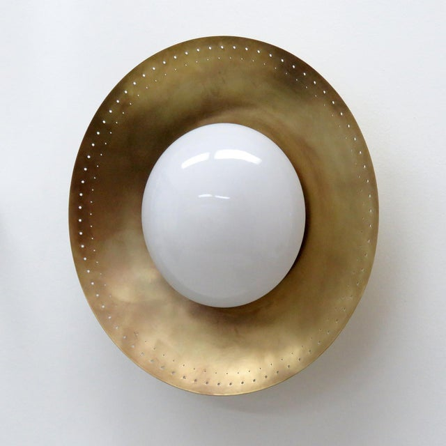 "Elegant custom ""Iowa"" wall or ceiling light designed by Gallery L7, with an opaline glass shade on a raw brass disc,..."
