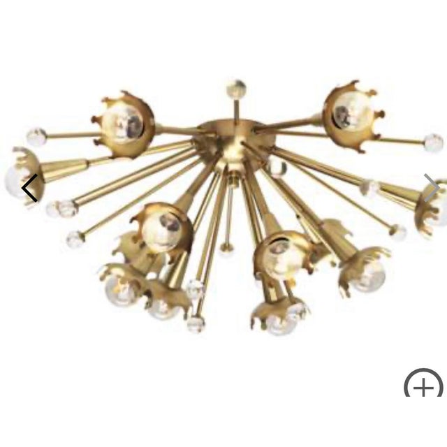 From Jonathan Adler by Robert Abbey comes this retro sputnik style flushmount ceiling light. Twelve crown shaped fixtures...