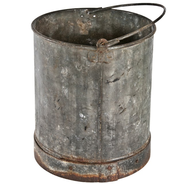 """Vintage galvanized bucket with reinforced band. Holes in bottom have been repaired with screws. 5""""h handle."""