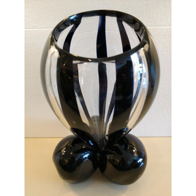 This is a great piece of Murano Art Glass by the Master Pino Signoretto. The clear and black striped vase tapers down to a...