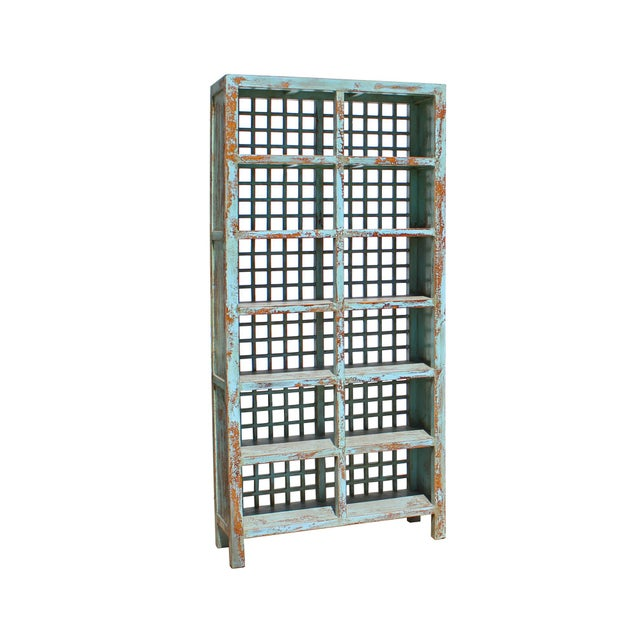 This bookcase or display cabinet is made of elm wood. The design is simple and open geometric pattern back. Natural wood,...