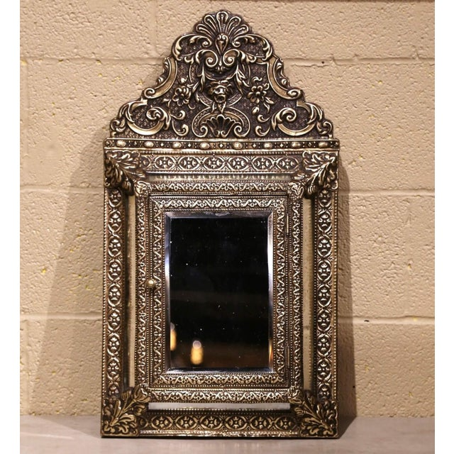 For ornate beauty with a secret compartment, look no further than this beautiful antique overlay brass mirror. Created in...