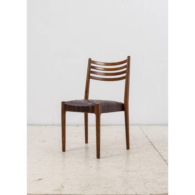 A stained beech chair with a thick webbed leather seating. The chair is attributed to Palle Suenson, as it comes from the...