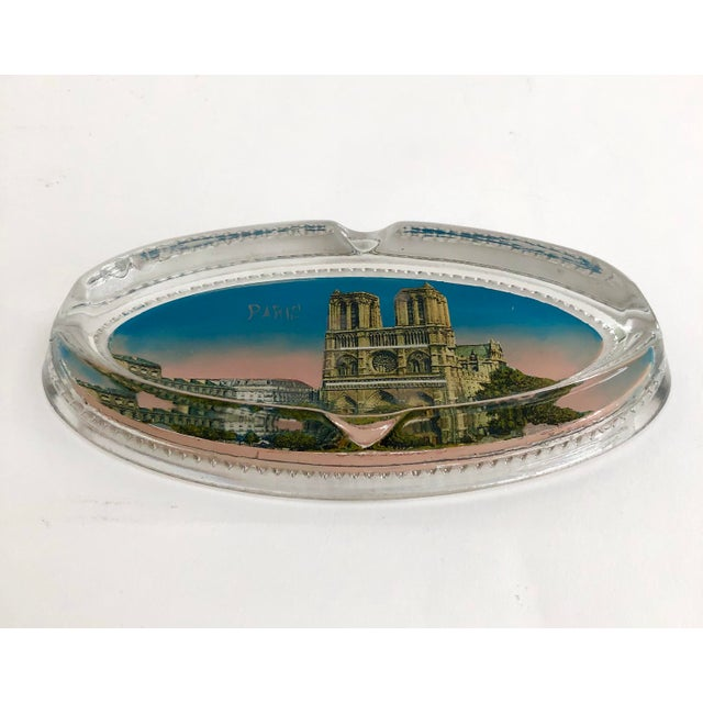 Charming Paris souvenir ashtray featuring the historic Notre Dame Cathedral. One of a kind keepsake that has survived...