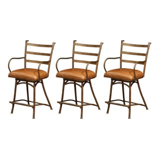 Set of Three French Rust Iron Swivel Stools With Brown Leather Seat For Sale