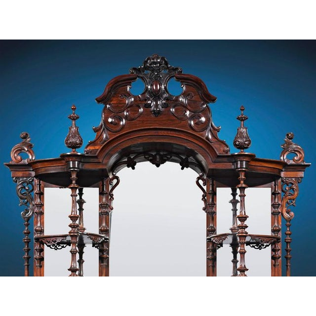 This monumental, museum-quality American Rococo Revival étagère was crafted by the renowned Brooklyn-based cabinetmaker...