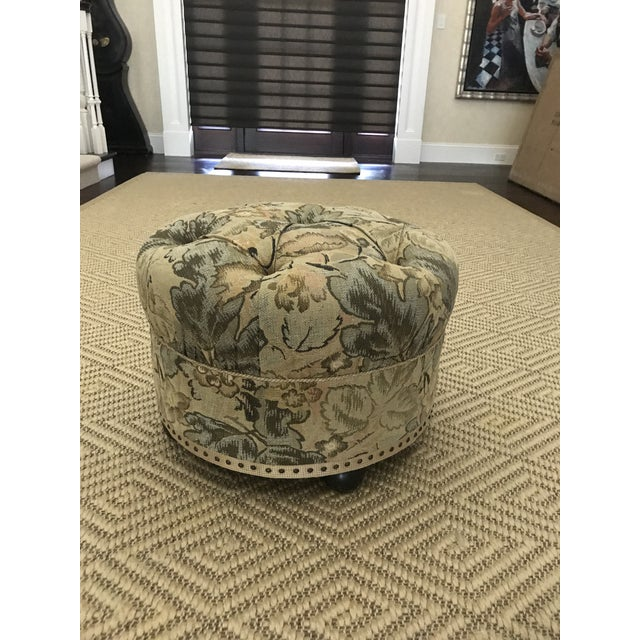 This is a beautiful floral upholstered ottoman/foot stool with dark brown wooden bun feet. The top of the ottoman is...