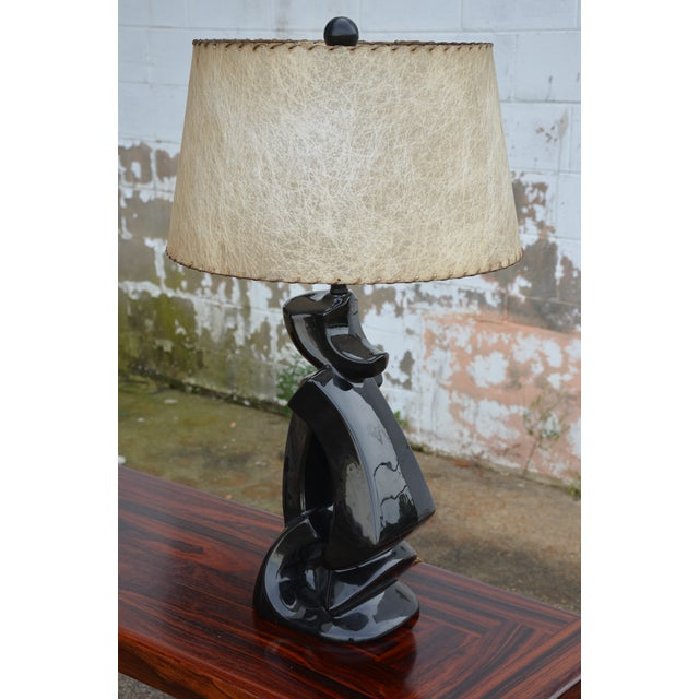 Incredible large scale mid-century modern black glazed, abstract form, ceramic table lamp with original laced fiberglass...