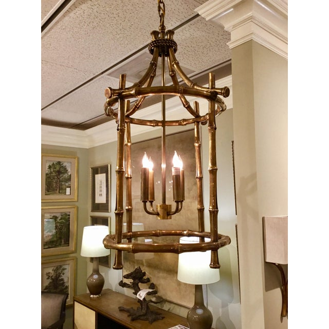 Transitional Currey & Co. Bansari lantern finished in antique brass, bamboo reed detail, four lights, showroom floor...