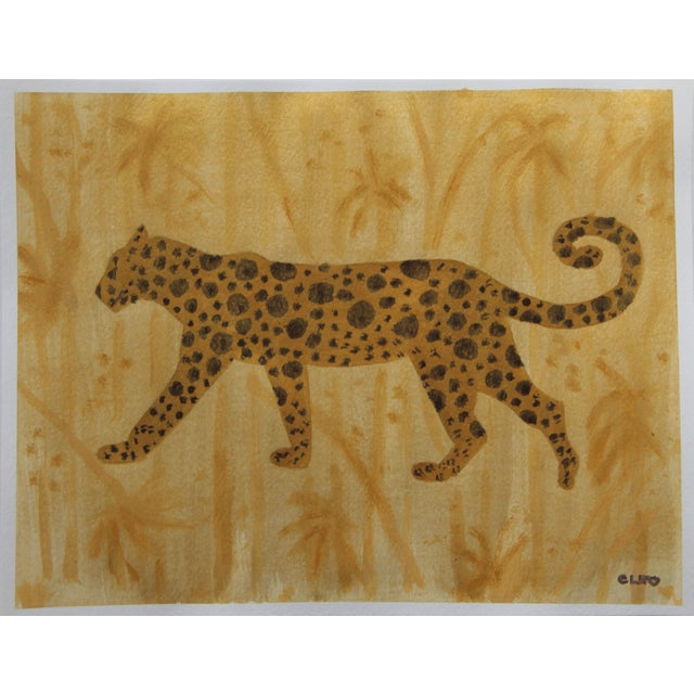 Abstract painting of leopard or cheetah in shades of gold on a textured gold background of bamboo or jungle foliage....