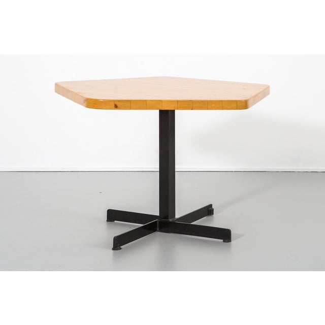 """A pentagonal table designed by Charlotte Perriand for Les Arcs 2000 in France, c 1968. Enameled steel and pine. 26 ⅜"""" h x..."""