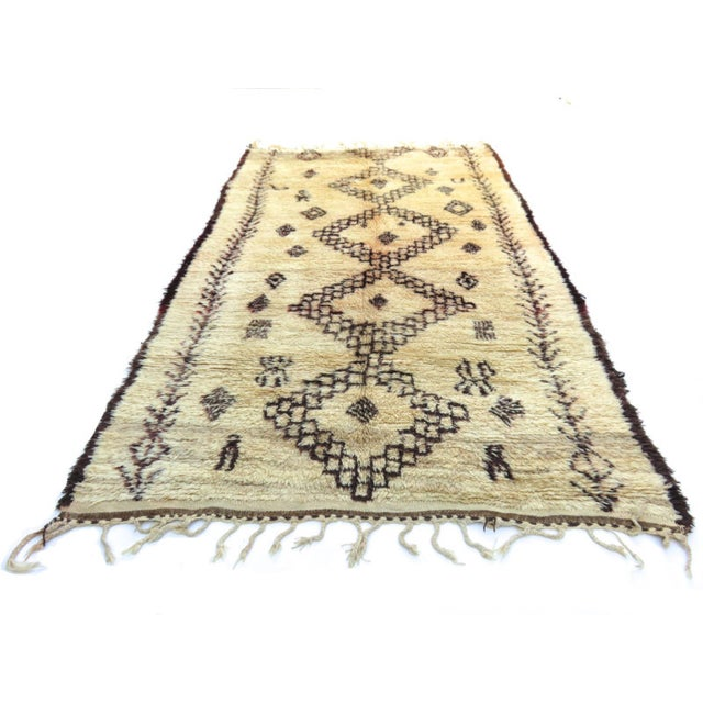 Vintage Marmoucha rug handwoven with ivory and deep burgundy silky wool in a Berber tribal pattern. Dimensions: 6' x 10'2