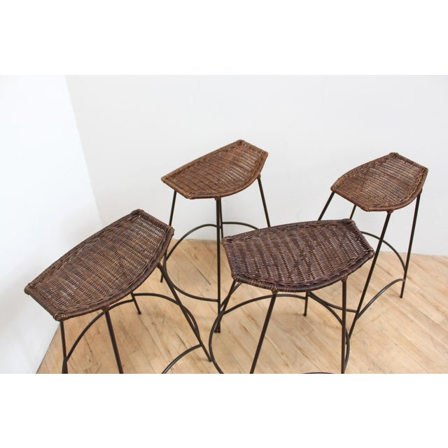 Exceptional set of minimalist Arthur Umanoff wicker and iron bar stools. These look like they were rarely used. Original...
