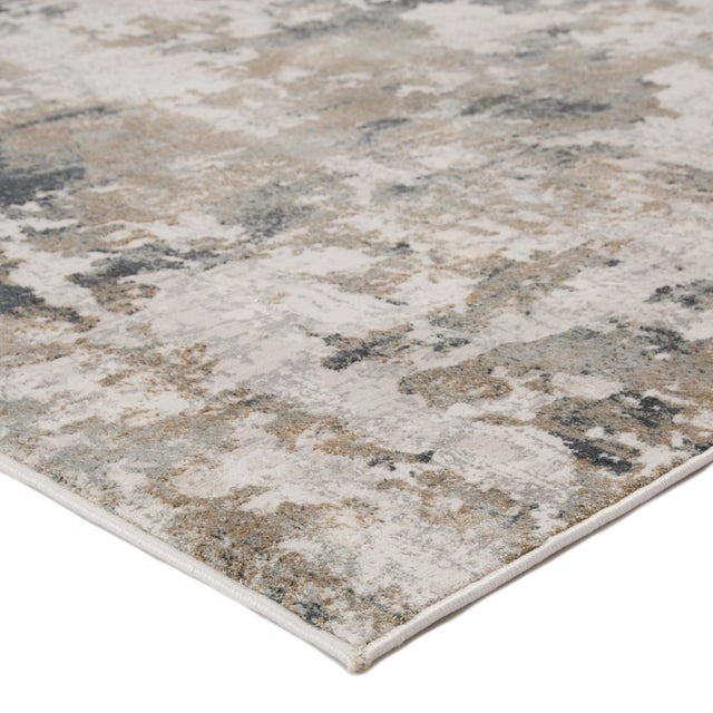 Muted color tones and abstract patterning combine to create the transitional appeal of this dappled area rug. Lustrous for...