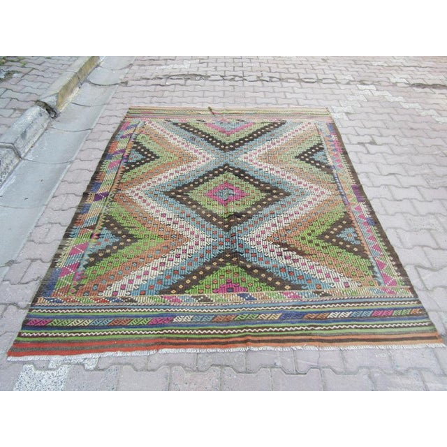 Handwoven Vintage kilim rug from Denizli region of Turkey. Approximately 50-60 years old.In very good condition.