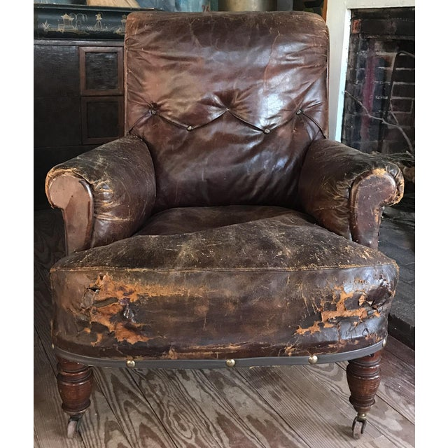 Distressed is the operative word to describe this cool old leather chair. We see it as a prop or a statement making piece...