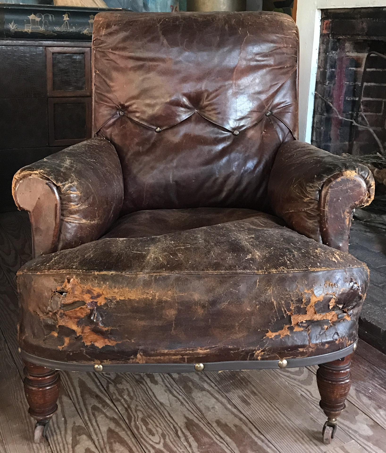 Distressed Is The Operative Word To Describe This Cool Old Leather Chair.  We See It