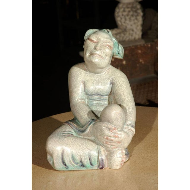 Rare, crackle glazed European figurative sculpture of an Asian figure similar to a Buddha, Luohan. Probably Royal...
