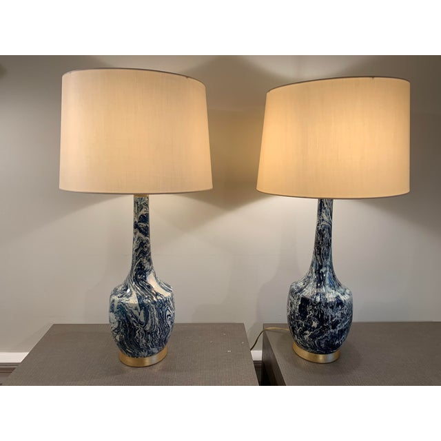 """Pair of blue and white table lamps in excellent condition from Bradburn Gallery. Shades included. Lamp with shade: 34""""..."""