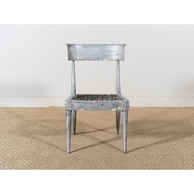 """Classic-form klismos chair. Alloy metal. """"Strapped"""" seat. May be be used outdoors. May be used with or without a cushion...."""